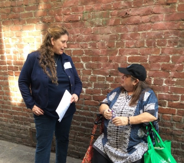 Dede Teeler confers with Elizabeth Davis of Marin City